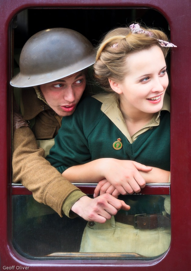 """Young Lovers In Wartime"" A young soldier and land army girl in 1940s costume"