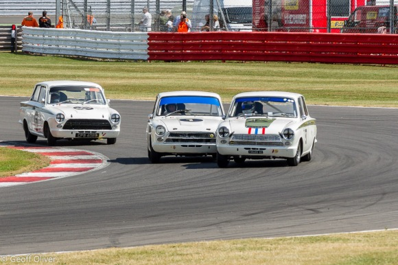It was a Lotus Cortina 1-2-3 in the Sir John Whitmore Trophy for Under 2 Litre Touring Cars with the Voyazides/Hadfield car seen here in the centre of the picture taking the win.